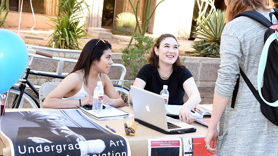 Students at a tabling event